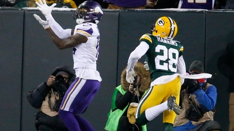 Minnesota Vikings' Stefon Diggs catches a touchdown pass in front of Green Bay Packers' Josh Hawkins during the first half of an NFL football game Saturday, Dec. 23, 2017, in Green Bay, Wis. (AP Photo/Mike Roemer)