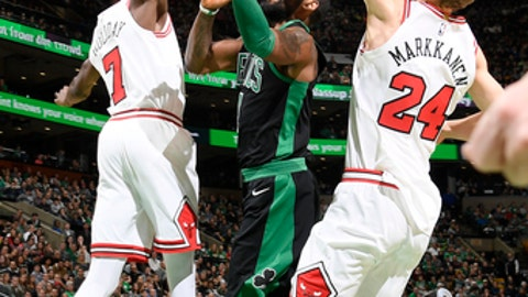 BOSTON, MA - DECEMBER 23: Kyrie Irving #11 of the Boston Celtics goes to the basket against the Chicago Bulls on December 23, 2017 at the TD Garden in Boston, Massachusetts. NOTE TO USER: User expressly acknowledges and agrees that, by downloading and or using this photograph, User is consenting to the terms and conditions of the Getty Images License Agreement. Mandatory Copyright Notice: Copyright 2017 NBAE (Photo by Brian Babineau/NBAE via Getty Images)