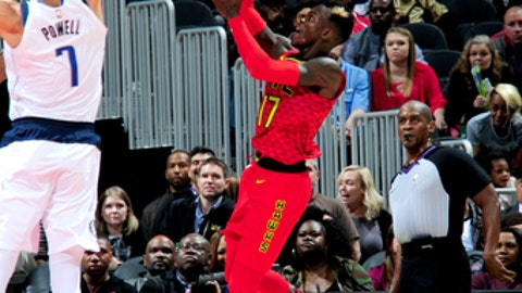 ATLANTA, GA - DECEMBER 23:  Dennis Schroder #17 of the Atlanta Hawks shoots the ball against the Dallas Mavericks on December 23, 2017 at Philips Arena in Atlanta, Georgia.  NOTE TO USER: User expressly acknowledges and agrees that, by downloading and/or using this Photograph, user is consenting to the terms and conditions of the Getty Images License Agreement. Mandatory Copyright Notice: Copyright 2017 NBAE (Photo by Scott Cunningham/NBAE via Getty Images)
