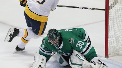 Dallas Stars goalie Ben Bishop (30) blocks a shot by Nashville Predators left wing Filip Forsberg (9) during an overtime shootout in an NHL hockey game in Dallas, Saturday, Dec. 23, 2017. The Stars won 4-3. (AP Photo/LM Otero)