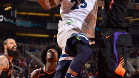 PHOENIX, AZ - DECEMBER 23: Jimmy Butler #23 of the Minnesota Timberwolves goes to the basket against the Phoenix Suns on December 23, 2017 at Talking Stick Resort Arena in Phoenix, Arizona. NOTE TO USER: User expressly acknowledges and agrees that, by downloading and/or using this photograph, user is consenting to the terms and conditions of the Getty Images License Agreement. Mandatory Copyright Notice: Copyright 2017 NBAE (Photo by Barry Gossage/NBAE via Getty Images)