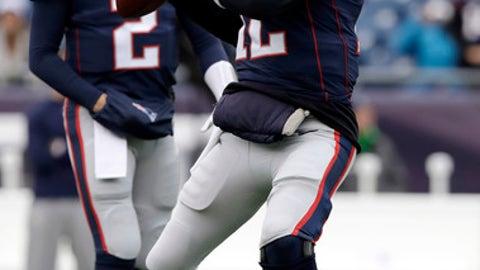 New England Patriots quarterback Tom Brady, right, warms up beside backup quarterback Brian Hoyer before an NFL football game against the Buffalo Bills, Sunday, Dec. 24, 2017, in Foxborough, Mass. (AP Photo/Charles Krupa)