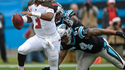 Tampa Bay Buccaneers' Jameis Winston (3) scrambles as Carolina Panthers' Shaq Green-Thompson (54) chases during the first half of an NFL football game in Charlotte, N.C., Sunday, Dec. 24, 2017. (AP Photo/Mike McCarn)