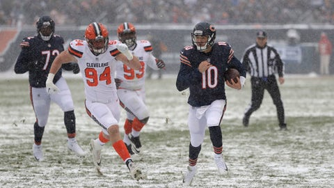 Chicago Bears quarterback Mitchell Trubisky (10) runs as Cleveland Browns defensive end Carl Nassib (94) chases in the first half of an NFL football game in Chicago, Sunday, Dec. 24, 2017. (AP Photo/Charles Rex Arbogast)