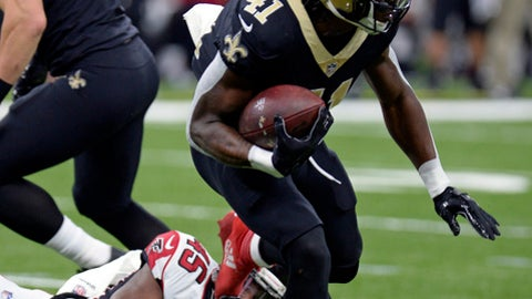 Atlanta Falcons middle linebacker Deion Jones (45) tries to tackle New Orleans Saints running back Alvin Kamara (41) in the first half of an NFL football game in New Orleans, Sunday, Dec. 24, 2017. (AP Photo/Bill Feig)