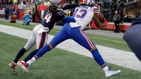 Buffalo Bills wide receiver Kelvin Benjamin can't make a catch in the end zone in front of New England Patriots cornerback Stephon Gilmore left during the first half of an NFL football game Sunday Dec. 24 2017 in Foxborough Mass. (AP Phot