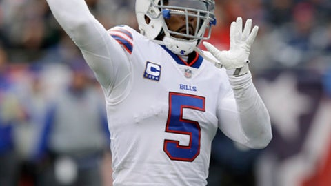 Buffalo Bills quarterback Tyrod Taylor passes against the New England Patriots during the first half of an NFL football game, Sunday, Dec. 24, 2017, in Foxborough, Mass. (AP Photo/Charles Krupa)