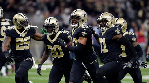 Orleans Saints cornerback Marshon Lattimore (23) celebrates an inception with teammates in the first half of an NFL football game against the Atlanta Falcons in New Orleans, Sunday, Dec. 24, 2017. (AP Photo/Bill Feig)