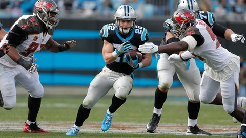 Carolina Panthers' Christian McCaffrey (22) runs as Tampa Bay Buccaneers' Ryan Russell (95) and Gerald McCoy (93) defend during the second half of an NFL football game in Charlotte, N.C., Sunday, Dec. 24, 2017. (AP Photo/Bob Leverone)
