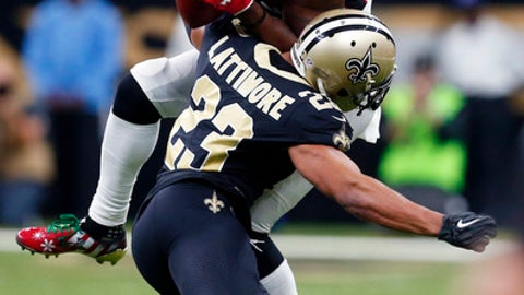 New Orleans Saints cornerback Marshon Lattimore (23) hits Atlanta Falcons wide receiver Mohamed Sanu (12) on a pass reception in the second half of an NFL football game in New Orleans, Sunday, Dec. 24, 2017. (AP Photo/Butch Dill)