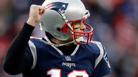New England Patriots quarterback Tom Brady celebrates his touchdown pass to Dion Lewis during the second half of an NFL football game against the Buffalo Bills, Sunday, Dec. 24, 2017, in Foxborough, Mass. (AP Photo/Charles Krupa)