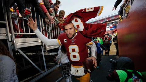 Washington Redskins quarterback Kirk Cousins (8) leaves the field after an NFL football game against the Denver Broncos in Landover, Md., Sunday, Dec 24, 2017. The Redskins defeated the Broncos 27-11. (AP Photo/Alex Brandon)