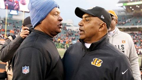 Detroit Lions head coach Jim Caldwell, left, meets with Cincinnati Bengals head coach Marvin Lewis after their NFL football game, Sunday, Dec. 24, 2017, in Cincinnati. (AP Photo/Gary Landers)