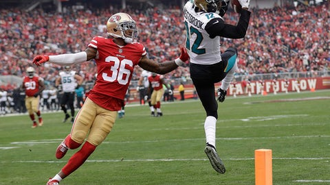 Jacksonville Jaguars wide receiver Dede Westbrook (12) catches a pass in front of San Francisco 49ers cornerback Dontae Johnson (36) during the first half of an NFL football game in Santa Clara, Calif., Sunday, Dec. 24, 2017. (AP Photo/Marcio Jose Sanchez)