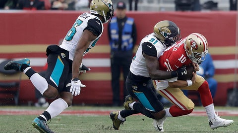 Jacksonville Jaguars defensive end Yannick Ngakoue (91) sacks San Francisco 49ers quarterback Jimmy Garoppolo (10) during the second half of an NFL football game in Santa Clara, Calif., Sunday, Dec. 24, 2017. (AP Photo/Marcio Jose Sanchez)
