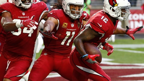Arizona Cardinals wide receiver John Brown (12) celebrates his touchdown with wide receiver Larry Fitzgerald (11) during the second half of an NFL football game against the New York Giants, Sunday, Dec. 24, 2017, in Glendale, Ariz. (AP Photo/Ross D. Franklin)