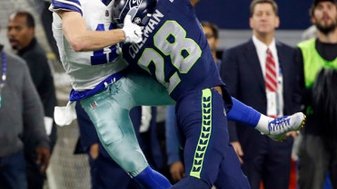 Seattle Seahawks cornerback Justin Coleman (28) breaks up a pass intended for Dallas Cowboys' Cole Beasley, left, in the second half of an NFL football game, Sunday, Dec. 24, 2017, in Arlington, Texas. Coleman was charged with pass interference on the play. (AP Photo/Ron Jenkins)
