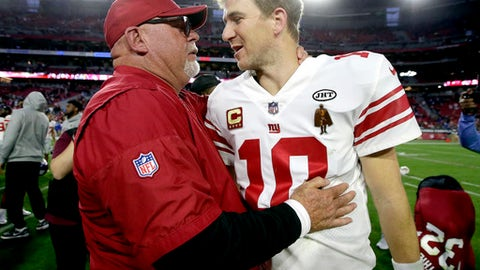 New York Giants quarterback Eli Manning (10) and Arizona Cardinals head coach Bruce Arians meet after an NFL football game, Sunday, Dec. 24, 2017, in Glendale, Ariz. The Cardinals won 23-0. (AP Photo/Rick Scuteri)