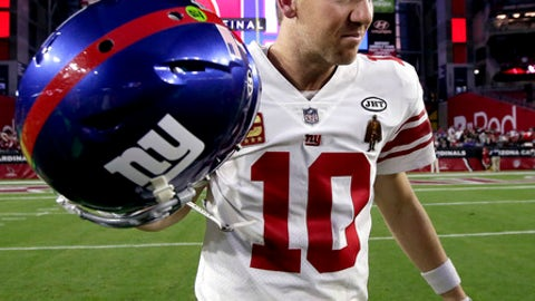 New York Giants quarterback Eli Manning (10) leaves the field after an NFL football game against the Arizona Cardinals, Sunday, Dec. 24, 2017, in Glendale, Ariz. The Cardinals won 23-0. (AP Photo/Rick Scuteri)