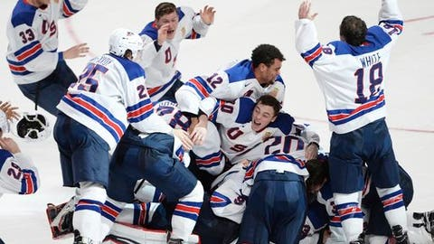 FILE - In this Jan. 5, 2017, file photo, United States players celebrate their victory over Canada in the final of the world junior championship in Montreal. The 10-nation tournament is being played at Buffalo, N.Y., and opens on Tuesday, Dec. 26. It will feature Canada and the U.S. playing an outdoor game at the NFL Buffalo Bills' New Era Field on Friday, Dec. 29. (Paul Chiasson/The Canadian Press via AP, File)