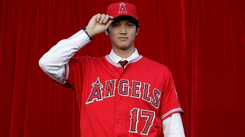 FILE - In this Dec. 9, 2017, file photo, Baseball player Shohei Ohtani, of Japan, poses for photos after a news conference at Angel Stadium, in Anaheim, Calif. Los Angeles Angels-bound Ohtani bid farewell to fans of his former Japanese club on Monday, Dec. 25, as he sets off to join his new team. (AP Photo/Jae C. Hong, File)