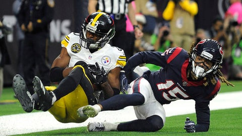 Pittsburgh Steelers cornerback Artie Burns intercepts a pass intended for Houston Texans wide receiver Will Fuller (15) in the end zone during the first half of an NFL football game Monday, Dec. 25, 2017, in Houston. (AP Photo/Eric Christian Smith)