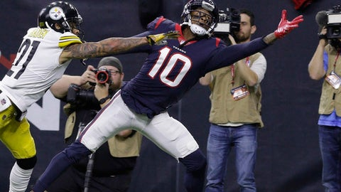 Houston Texans wide receiver DeAndre Hopkins (10) reaches for a pass as Pittsburgh Steelers cornerback Joe Haden (21) defends during the first half of an NFL football game Monday, Dec. 25, 2017, in Houston. The pass was incomplete. (AP Photo/Michael Wyke)