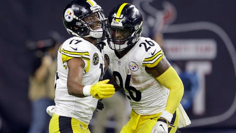 Pittsburgh Steelers running back Le'Veon Bell (26) celebrates with JuJu Smith-Schuster (19) after scoring a touchdown against the Houston Texans during the second half of an NFL football game Monday, Dec. 25, 2017, in Houston. (AP Photo/Michael Wyke)