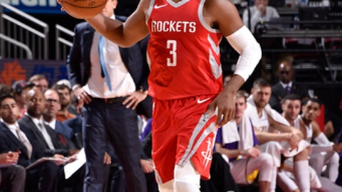HOUSTON, TX - DECEMBER 20: Chris Paul #3 of the Houston Rockets handles the ball against the Los Angeles Lakers on December 20, 2017 at the Toyota Center in Houston, Texas. NOTE TO USER: User expressly acknowledges and agrees that, by downloading and or using this photograph, User is consenting to the terms and conditions of the Getty Images License Agreement. Mandatory Copyright Notice: Copyright 2017 NBAE (Photo by Bill Baptist/NBAE via Getty Images)