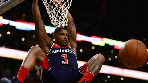 BOSTON, MA - DECEMBER 25:  Bradley Beal #3 of the Washington Wizards dunks during the second quarter of the game against the Boston Celtics at TD Garden on December 25, 2017 in Boston, Massachusetts. NOTE TO USER: User expressly acknowledges and agrees that, by downloading and or using this photograph, User is consenting to the terms and conditions of the Getty Images License Agreement.  (Photo by Omar Rawlings/Getty Images)