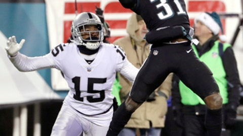 Philadelphia Eagles' Jalen Mills (31) breaks up a pass intended for Oakland Raiders' Michael Crabtree (15) during the second half of an NFL football game, Monday, Dec. 25, 2017, in Philadelphia. (AP Photo/Michael Perez)