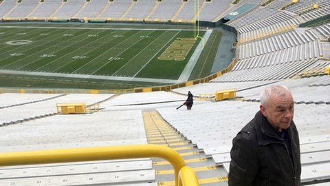 "In this Dec. 6, 2017, photo, Patrick Webb, executive director of the Green Bay/Brown County Professional Football Stadium District, recalls watching a game known as the ""Ice Bowl,"" at Lambeau Field in Green Bay, Wis. Webb spoke from near the spot where he stood during the game 50 years ago between the Dallas Cowboys and Green Bay Packers played in sub-zero temperatures. (AP Photo/Genaro C. Armas)"