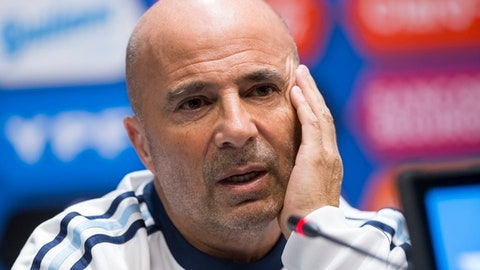 FILE - In this Friday, Nov. 10, 2017 filer, Argentina coach Jorge Sampaoli speaks to the media after his team's training session ahead of their friendly soccer match against Russia, in Moscow. Argentina coach Jorge Sampaoli has apologized for insulting a traffic officer who stopped him at a checkpoint. Sampaoli says in a statement on Tuesday, Dec. 26 he's sorry for belittling the officer over his pay grade. (AP Photo/Alexander Zemlianichenko, File)
