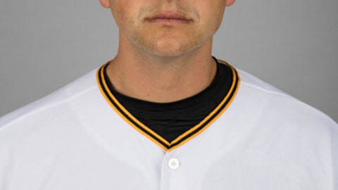 This is a 2017 photo shows Jared Hughes of the Pittsburgh Pirates. Reliever Hughes and the Cincinnati Reds have agreed to a $4.5 million, two-year contract that includes a club option for 2020. Hughes gets $2,125,000 in each of the next two seasons under the deal announced Tuesday, Dec. 26, 2017, and the Reds have a $3 million option with a $250,000 buyout. (AP Photo/Matt Rourke)