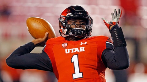 Utah quarterback Tyler Huntley (1) throws the ball during practice before the start of their NCAA college football game against Colorado Saturday, Nov. 25, 2017, in Salt Lake City. (AP Photo/Rick Bowmer)