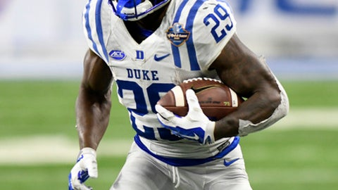 Duke running back Shaun Wilson (29) runs against Northern Illinois during the second quarter of the Quick Lane Bowl NCAA college football game, Tuesday, Dec. 26, 2017, in Detroit. (AP Photo/Jose Juarez)