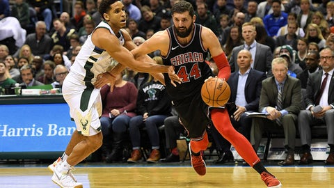 MILWAUKEE, WI - DECEMBER 26:  Nikola Mirotic #44 of the Chicago Bulls drives around Malcolm Brogdon #13 of the Milwaukee Bucks during the second half of a game at the Bradley Center on December 26, 2017 in Milwaukee, Wisconsin.  NOTE TO USER: User expressly acknowledges and agrees that, by downloading and or using this photograph, User is consenting to the terms and conditions of the Getty Images License Agreement.  (Photo by Stacy Revere/Getty Images)