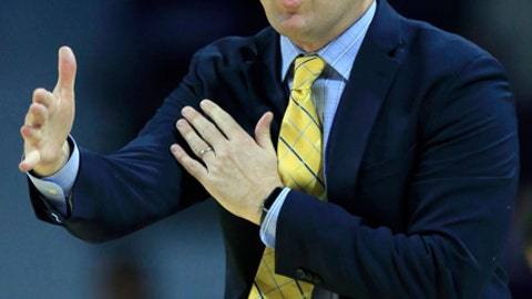 FILE - In this Nov. 20, 2017, file photo, Northern Arizona head coach Jack Murphy directs his team during the first half of an NCAA college basketball game against Kansas State, in Manhattan, Kan. The top programs in college basketball have state-of-the-art practice facilities and play in arenas that would make some pro teams jealous. At the low end of Division I basketball, the workout rooms can be a haphazard array of random weights and the gym of the bandbox variety, often not even on campus. (AP Photo/Orlin Wagner, File)