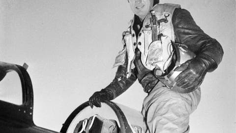 FILE - In this 1953 file photo, Capt. Ted Williams, former Boston Red Sox slugger, poses atop an airplane at a Marine air base in Korea after he crash landed his thunder jet at an advance airbase Feb. 15, 1953, on his first combat mission over North Korea against enemy targets. Thirty-eight letters from Williams to his girlfriend at the time are going to be auctioned on Jan. 3, 2018, at Saco River Auction in Biddeford, Maine. (AP Photo/Fred Waters, File)