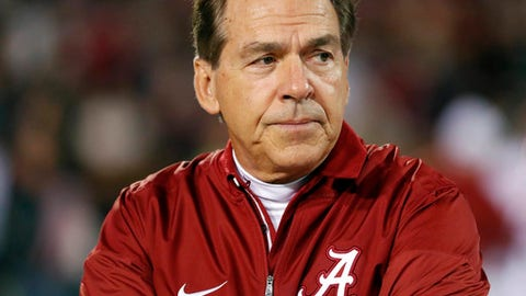 File- This Nov. 11, 2017, file photo shows Alabama coach Nick Saban watching his team warm up for an NCAA college football game against Mississippi State in Starkville, Miss. Saban has made reloading into a science at Alabama. In his words, the process. NFL draft picks exit. Similarly talented high school prospects enter. The machinery keeps running. (AP Photo/Rogelio V. Solis, File)