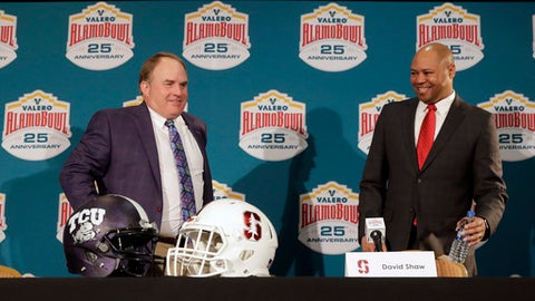 TCU head coach Gary Patterson, left, and Stanford head coach David Shaw, right, take part in a news conference for the Alamo Bowl NCAA college football game, Wednesday, Dec. 27, 2017, in San Antonio. The game is scheduled for Thursday, Dec. 28. (AP Photo/Eric Gay)