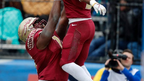 Florida State running back Cam Akers, right, celebrates his touchdown with offensive lineman Derrick Kelly II, left,  in the first half of the Independence Bowl NCAA college football game against Southern Mississippi in Shreveport, La., Wednesday, Dec. 27, 2017. (AP Photo/Gerald Herbert)