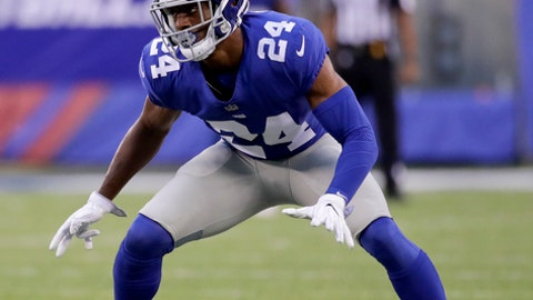 """File- This Aug. 11, 2017, file photo shows New York Giants cornerback Eli Apple (24) waiting for the snap during the first quarter of an NFL football game in East Rutherford, N.J. A day after Pro Bowl safety Landon Collins referred to him as a cancer, Apple has been suspended by the New York Giants for the season finale against the Washington Redskins. The Giants announced the suspension late Wednesday, Dec. 27, 2017, after Apple had participated in the practice. Interim general manager Kevin Abrams and interim coach Steve Spagnuolo informed him of the suspension. Abrams says Apple was suspended for a """"pattern of behavior that is conduct detrimental to the team.""""(AP Photo/Julio Cortez, File)"""