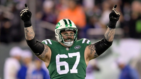 FILE - This Nov. 2, 2017 file photo shows New York Jets offensive guard Brian Winters (67) gesturing during the second half of an NFL football game against the Buffalo Bills in East Rutherford, N.J. The Jets have placed guard Winters on injured reserve with an abdominal injury that he has been dealing with for most of the season. They promoted defensive lineman Deon Simon from the practice squad on Wednesday, Dec. 27, 2017 to take Winters' place. (AP Photo/Bill Kostroun, file)