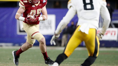 Boston College tight end Tommy Sweeney (89) runs with the ball as Iowa defensive back Matt Hankins (8) sets up against him during the second quarter of the Pinstripe Bowl NCAA college football game, Wednesday, Dec. 27, 2017, in New York. (AP Photo/Kathy Willens)