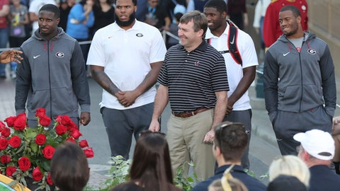 Georgia players Sony Michel, Isaiah Wynn, Roquan Smith, and Nick Chubb, from left, and coach Kirby Smart, front, are introduced are introduced at a Rose Bowl news conference Wednesday, Dec. 27, 2017, in Anaheim, Calif. (Curtis Compton/Atlanta Journal-Constitution via AP)