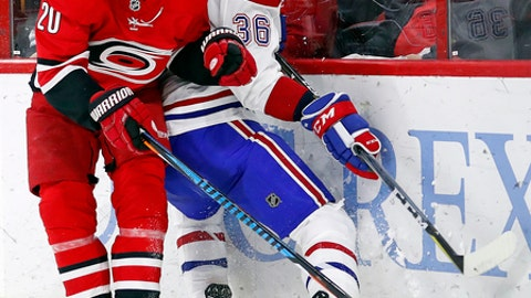 Carolina Hurricanes' Sebastian Aho (20) collides with Montreal Canadiens' Brett Lernout (36) during the second period of an NHL hockey game, Wednesday, Dec. 27, 2017, in Raleigh, N.C. (AP Photo/Karl B DeBlaker)