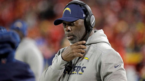 FILE - In this Dec. 16, 2017, file photo, Los Angeles Chargers coach Anthony Lynn adjusts his headset before the team's NFL football game against the Kansas City Chiefs in Kansas City, Mo. The Chargers have a chance to make the playoffs after their 0-4 start, but they can't do it without a win over the Oakland Raiders on Sunday and some help elsewhere in the league. Lynn plans to prevent video boards at StubHub Center from showing the scores of other NFL games while the Chargers finish out their season. (AP Photo/Charlie Riedel, File)