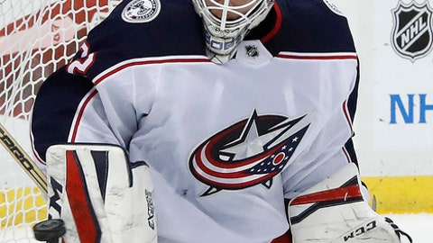 Columbus Blue Jackets goalie Sergei Bobrovsky blocks a shot during the second period of an NHL hockey game against the Pittsburgh Penguins in Pittsburgh, Wednesday, Dec. 27, 2017. (AP Photo/Gene J. Puskar)