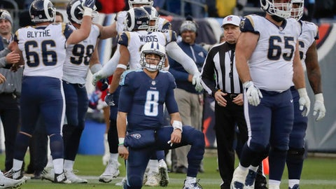 FILE - In this Dec. 24, 2017, file photo, Tennessee Titans quarterback Marcus Mariota (8) looks up at the scoreboard as Los Angeles Rams celebrate after Mariota threw an incomplete pass to end the Titans' final drive in an NFL football game in Nashville, Tenn. Mariota is about to do something he couldn't manage in each of his first two seasons: Play in the season finale. The third-year Titans quarterback is facing lots of criticism for backsliding in his third year even as Tennessee is poised to end a playoff drought with a win against Jacksonville. (AP Photo/James Kenney, File)
